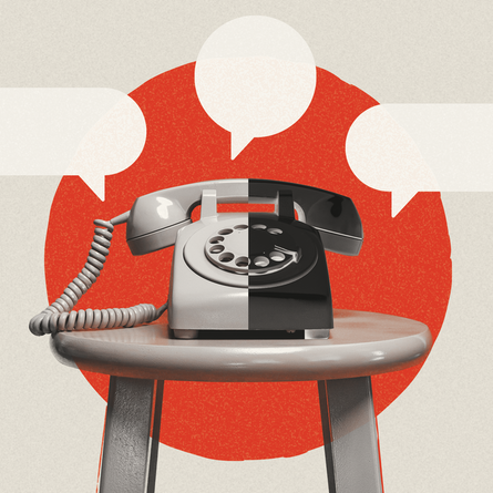 A telephone on a stool with black speech bubbles surrounding it.