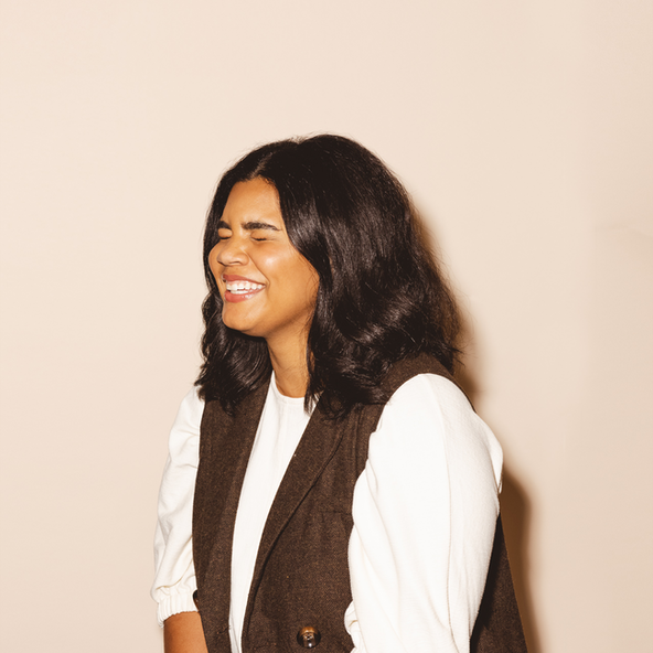 Headshot style for Salesloft. A woman laughing