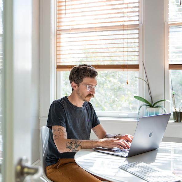 A designer works on a laptop
