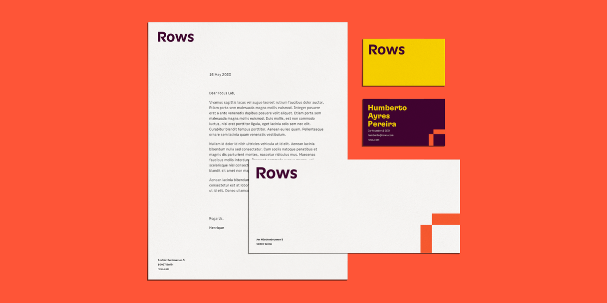 Branded letterhead, envelope, and business cards on a red background